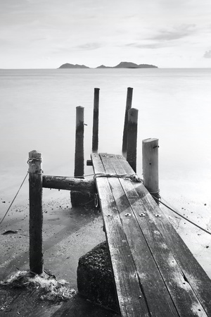 pier go into sea , black and white