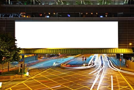 big empty billboard at night in city photo