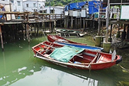 stilt house: Tai O fishing village with stilt house and old boat