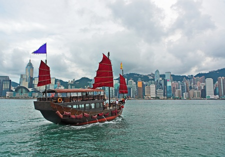 Hong Kong harbour with tourist junk photo