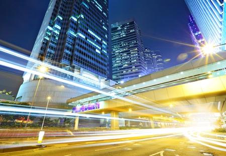 Traffic through the city at night photo