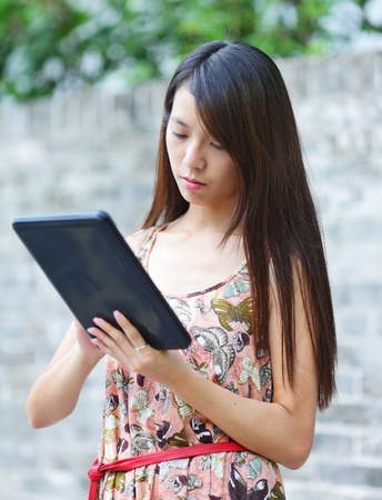 young woman using tablet touch computer photo