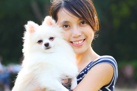 Young girl with dog Stock Photo - 10847733