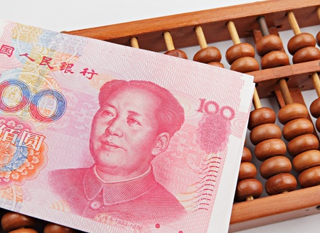 abacus and china dollar banknote photo