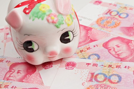 piggy bank on china banknote photo