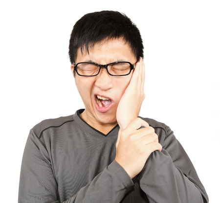 mouth pain: Man with pain expression on white Stock Photo