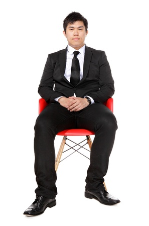 young asian business man sitting photo