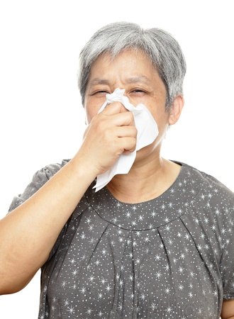 sneezing mature woman photo