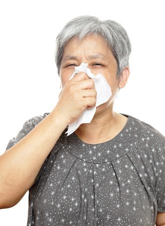 sneezing mature woman photo