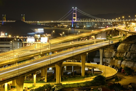 freeway and bridge at night photo