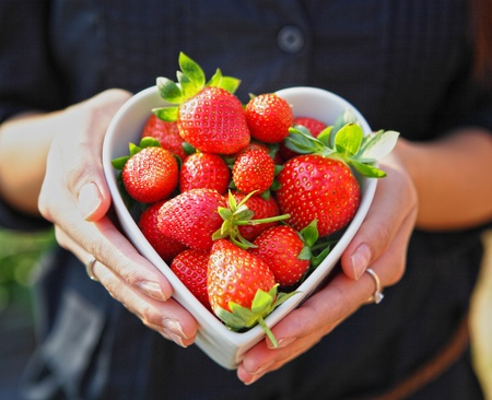 strawberry in heart shape bowl Stock Photo