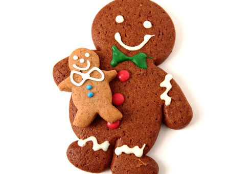 Gingerbread man cookies on white background photo