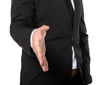 business man extending hand to shake photo