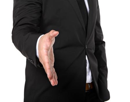 business man extending hand to shake Stock Photo - 11855721