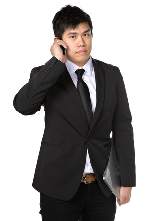 young business man with mobile phone photo