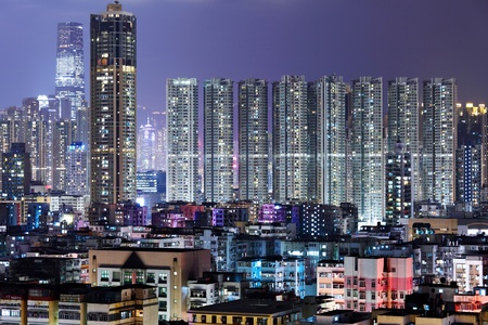 crowded building at night in Hong Kong photo