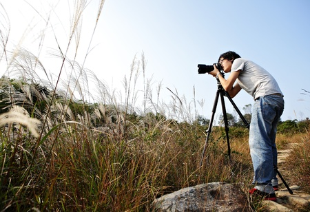 photographer taking photo in wild Stock Photo - 12005188