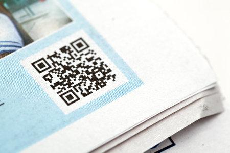 qr code on news paper Stock Photo - 12189470