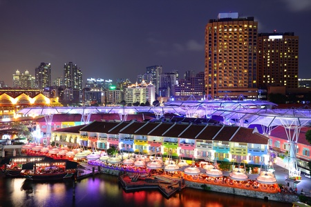 quayside: Singapore city at night Editorial