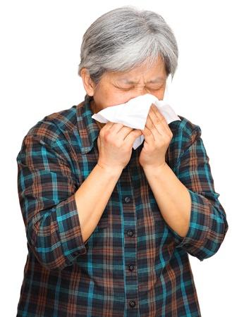 running nose: sneezing woman
