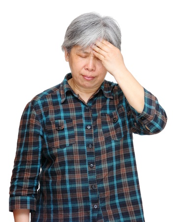 mature asian woman with headache photo