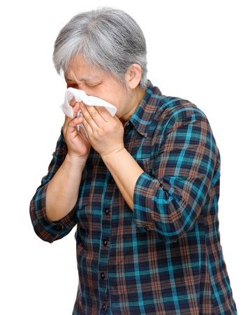 running nose: mature asian woman sneezing Stock Photo
