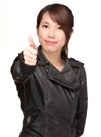 asian woman with thumb up over white background photo
