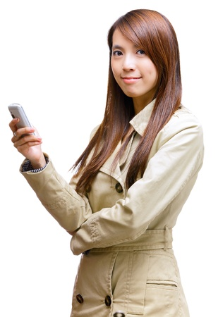 asian young woman using mobile phone message Stock Photo - 12983378