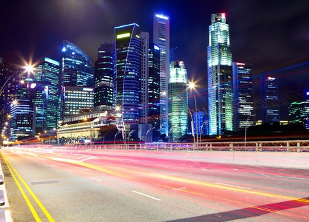 Singapore at night with traffic road photo