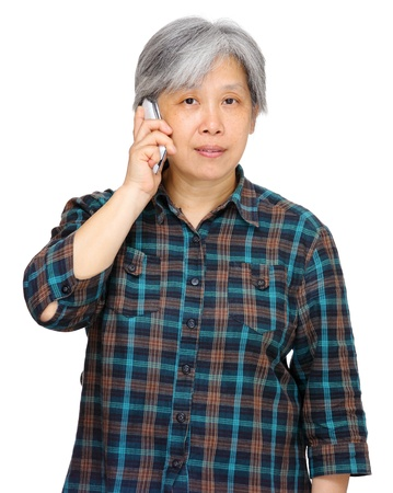 mature woman using mobile phone photo