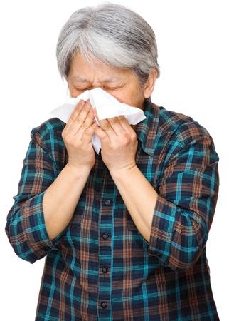 mature asian woman sneezing photo