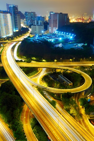 Highway at night in modern city photo