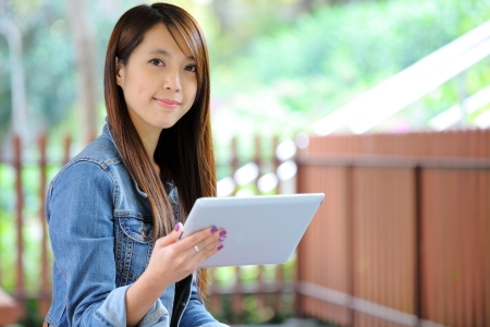 netbooks: young asian woman with tablet computer outdoor Stock Photo