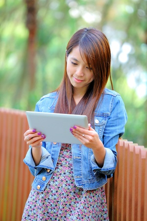 young asian woman with tablet pc photo