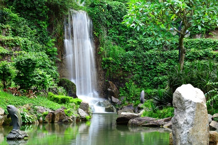 calm down: waterfall in park Stock Photo