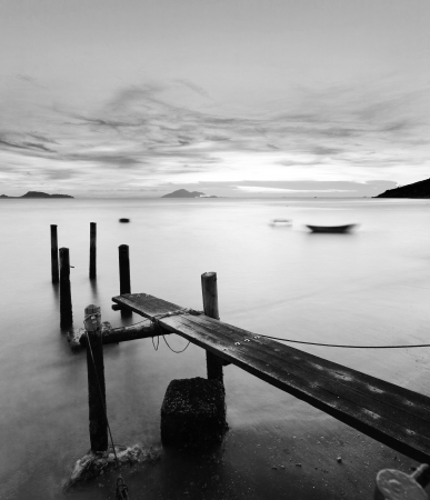 morn: pier at sunset in black and white Stock Photo