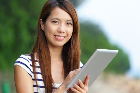 asian woman using tablet computer photo