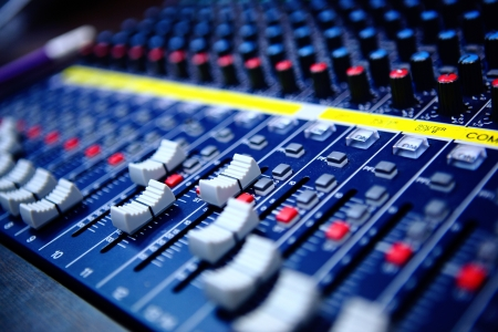 music production: controls of audio mixing console
