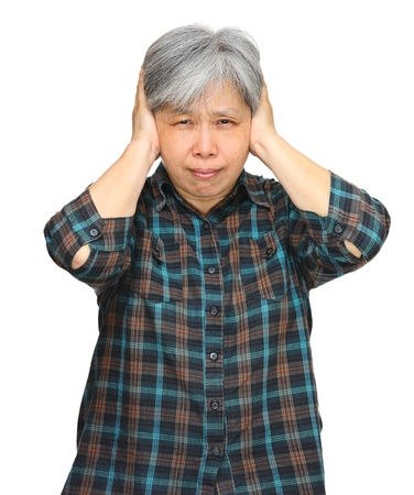 asian mature woman closing ears with hands photo