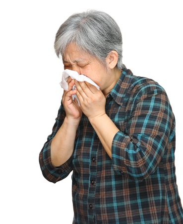 sneezing mature asian woman photo