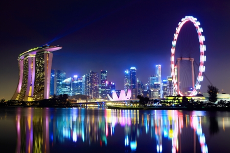 singapore culture: Singapore city skyline at night Editorial