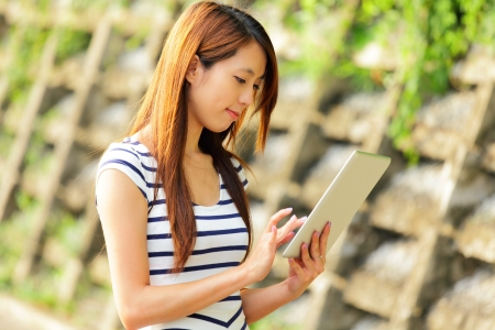 young asian woman with tablet computer outdoor Stock Photo - 15920277