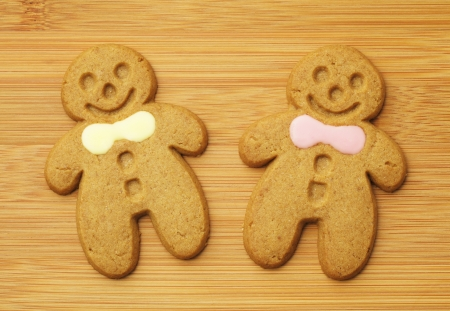 gingerbread man over wooden background photo