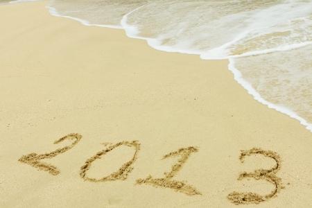 2013 written in sand on beach Stock Photo - 17433002