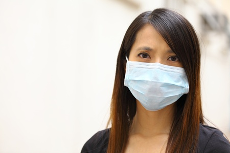 contagion: Asian woman wearing face mask Stock Photo