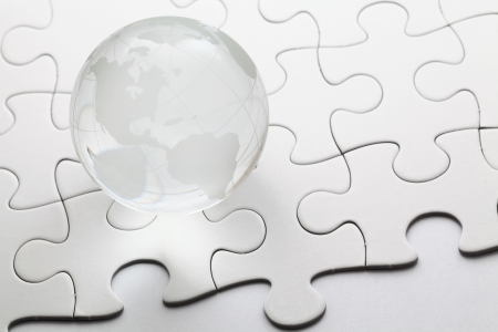glass globe with puzzle background photo