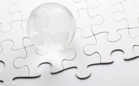 Glass globe ball with puzzle background photo