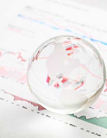 Glass earth ball on the financial chart photo
