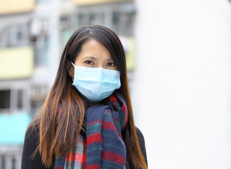 disease prevention: woman wearing face mask