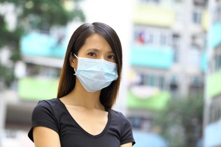 deterrence: Asian woman wear protective face mask Stock Photo